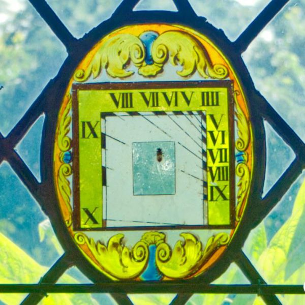 Stained Glass Sundial Window At Berkeley Castle