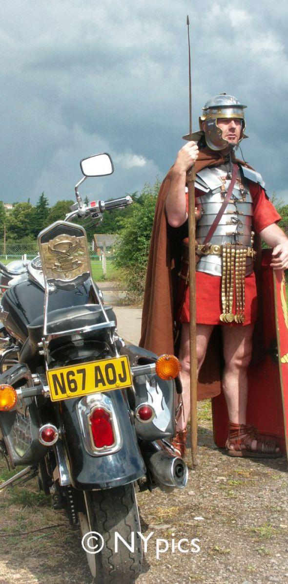 Roman Legionary Soldier Guarding A Motorbike