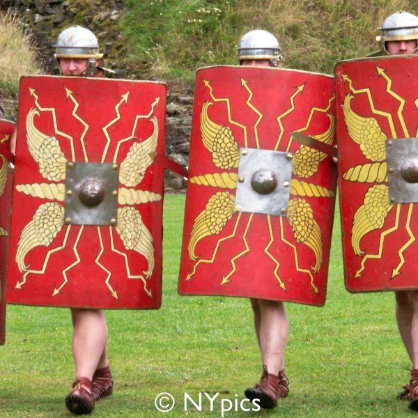 Roman Legionary Soldiers Behind Their Shields